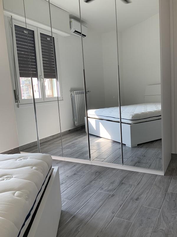 camera matrimoniale bilocale in affitto a milano